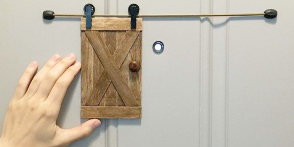 Apartment Design Hack: DIY Mini Barn Door For Your Peephole