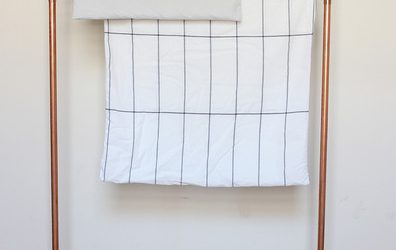 Small Apartment DIY: Pipe Towel Rack by Lonny.com